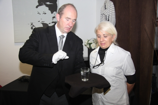 (Copyright/Byline: Miller & Maclean) Bespoke Bureau head butler trainer Steve Ford teaches student Giogia Candi the skills needed for top level domestic work. London butler agencies have reported a surge in interest from super-wealthy clients wanting butlers.
