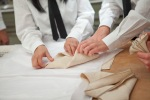 Napkin folding-British Butler Academy in training-Bespoke Bureau Copyright